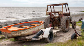 Tractor and boat Royalty Free Stock Photos