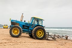Tractor and boat trailer ready on the beach Royalty Free Stock Image