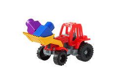 Tractor in the bucket carries designer items. Red Tractor in the bucket carries designer items Royalty Free Stock Image