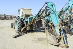Tractor with a bucket for digging soil. Bulldozer and grader. Russia, Temryuk - 15 July 2015: Tractor. Bulldozer and grader. Tractor with a bucket for digging Royalty Free Stock Photo