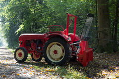 Tractor with cable winch during work in forest Royalty Free Stock Image