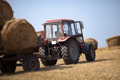 Tractor carries a haystack Royalty Free Stock Image