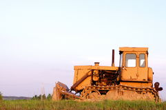 Tractor cat in a field and sky background Stock Photos