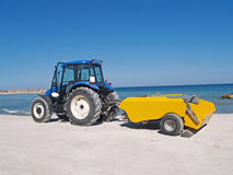 Tractor clean the beach. Early morning beach cleanup with a tractor Royalty Free Stock Photos