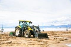 Tractor clean beach on coastline Costa Dorada, Salou, Spain. Tractor clean beach on coastline Costa Dorada, Salou, Spain Royalty Free Stock Photos