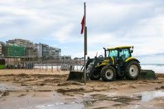 Tractor clean beach on coastline Costa Dorada, Salou, Spain. Tractor clean beach on coastline Costa Dorada, Salou, Spain Stock Photo