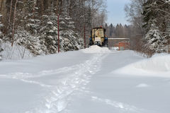 Tractor clean snow-covered road Stock Image