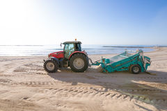 Tractor cleaning sand in Els Terrers Beach of Benicassim Royalty Free Stock Images