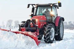 Tractor cleaning snow Royalty Free Stock Images
