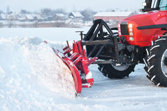 Tractor cleaning snow Stock Photo