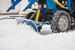 Tractor cleaning snow in city Stock Image
