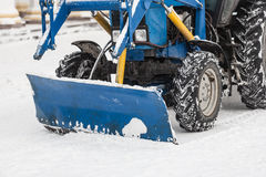 Tractor cleaning snow in city Royalty Free Stock Photography