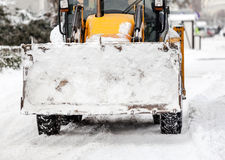 Tractor cleaning snow in city Royalty Free Stock Photo