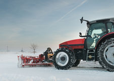 Tractor cleaning snow Royalty Free Stock Image