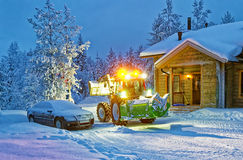 Tractor cleaning snow near house in winter finland Stock Images