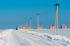 Tractor cleaning snow on road about new building Royalty Free Stock Photo