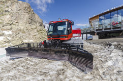 Tractor cleaning snow on the ski slopesto the top of the mountain at an altitude of 2400 meters in the Alps Royalty Free Stock Photography