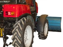 Tractor for cleaning streets. Red tractor on black rubber wheels for cleaning sidewalks and streets stock images