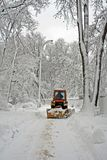Tractor cleaning winter road Royalty Free Stock Image