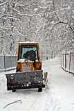 Tractor cleaning winter road Royalty Free Stock Photo