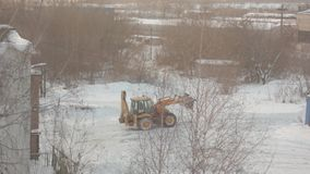 Tractor cleans snow stock video