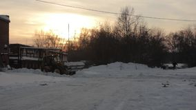 Tractor cleans snow stock video footage