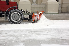 Tractor cleans the snow Stock Image