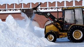The tractor cleans snow. stock footage