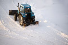 tractor cleans snow royalty free stock images
