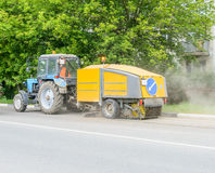Tractor cleans the street Royalty Free Stock Photos