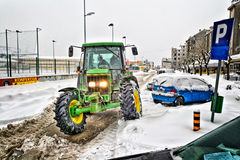 Tractor cleans the streets of large amounts of snow Royalty Free Stock Images