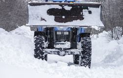 Tractor clearing snow Royalty Free Stock Image