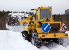 The tractor clears snow from the road blockage Royalty Free Stock Photography