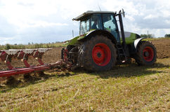 Tractor closeup plow furrow agriculture field. Tractor equipment start plow new trench furrow in agriculture field Stock Photography
