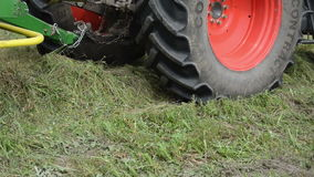Tractor collect hay field. Closeup special machine baler equipment collect gather hay in agriculture field stock footage