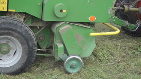Tractor collect hay field. Follow special machine tractor equipment collecting hay in agriculture field stock video