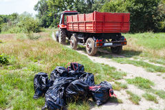 Tractor collecting garbage bags Royalty Free Stock Photography