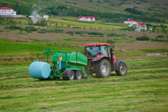 Tractor collecting haystack Royalty Free Stock Photos