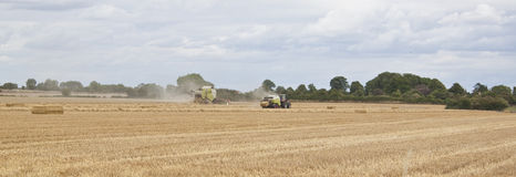 Tractor and combine working the field Royalty Free Stock Photo