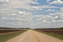 Tractor coming down gravel road Royalty Free Stock Photography