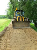 Tractor compares embankments Stock Photography