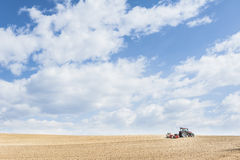 Tractor compresses the soil after planting with rollers. Stock Photography