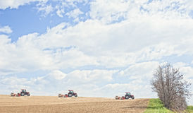 Tractor compresses the soil after planting with rollers. Royalty Free Stock Image