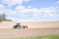 Tractor compresses the soil after planting with rollers. Royalty Free Stock Photography