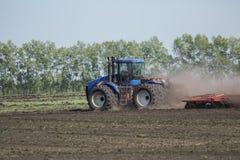 Tractor con la paleta Fotos de archivo