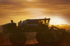 Tractor on the Corn Field. In Sunset. Illinois, USA. Agriculture Photo Collection Stock Photos
