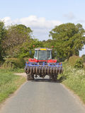 Tractor on a country road Stock Images
