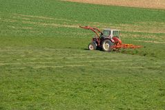 Tractor in countryside field Royalty Free Stock Images