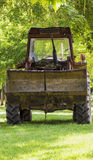 Tractor in the countryside. The tractor resting in the shade on a hot summer Royalty Free Stock Images