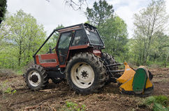 Tractor. Coupled with a brush cutter tractor clearing the forest Royalty Free Stock Images